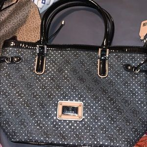Guess black with good under neath purse